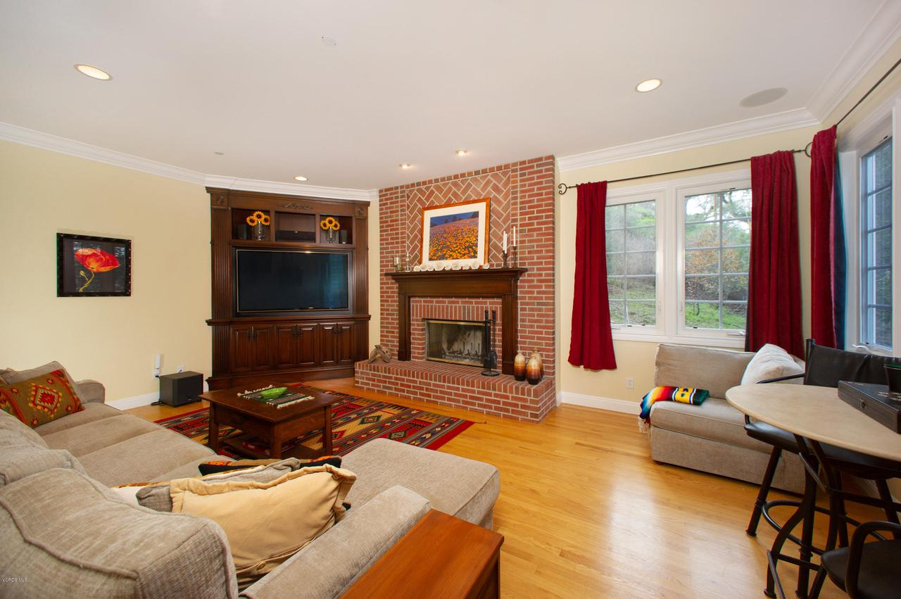 115 GILES, Lake Sherwood, CA 91361 - Media Cabinet and Fireplc in Family Room