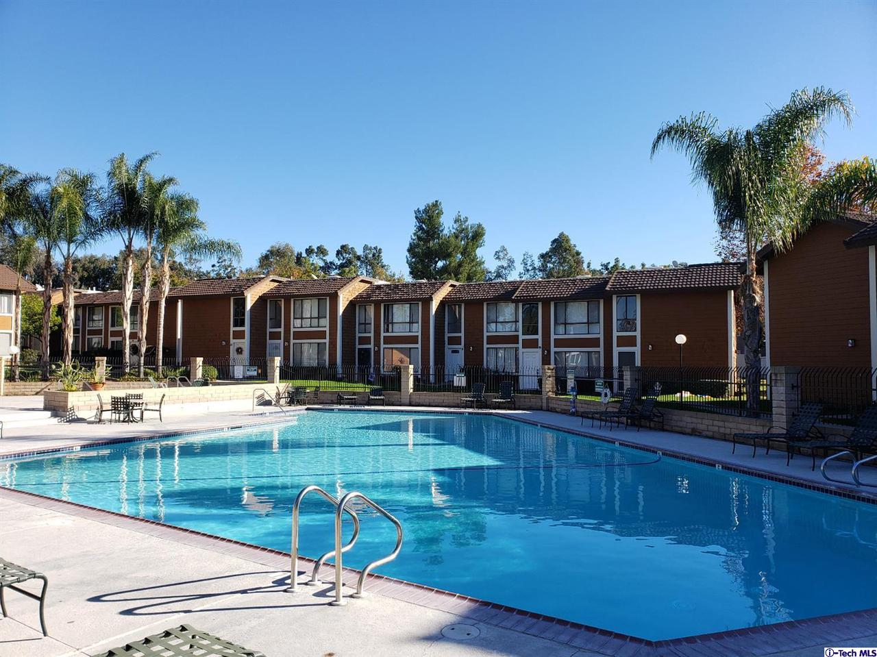25885 TRABUCO, Lake Forest, CA 92630 - Sparkling association pool and deck area.